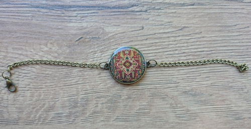 Rounded glazed bracelet with Armenian ornaments, by Anahit Harutyunyan