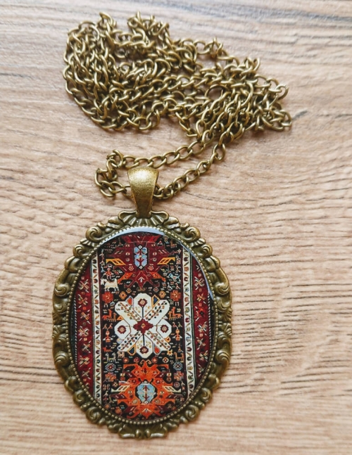 Oval glazed necklace with Armenian ornaments, by Anahit Harutyunyan
