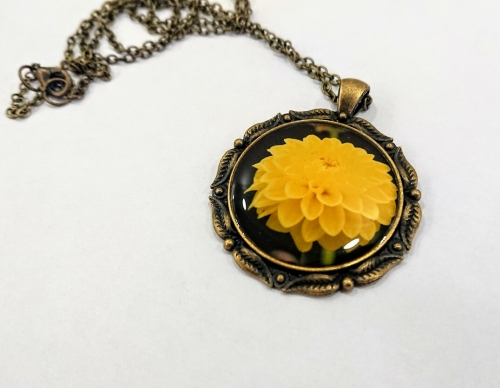 Rounded glazed necklace with the image of flowers, by Anahit Harutyunyan